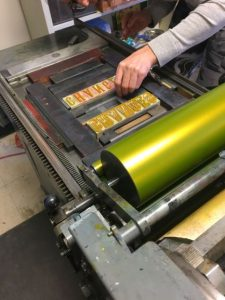 Student works with the letterpress machine