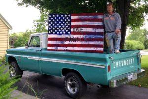Sean Manning standing in truckbed