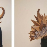 Frontal and side view of a large spiky mask.