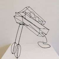Wire sculpture of an electric mixer.