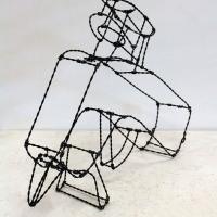 Wire sculpture of a hot glue gun.