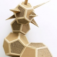 Abstract sculpture of geometric shapes stacked on top of one another.