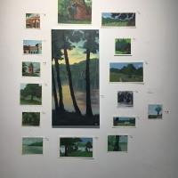 Photo of multiple paintings of landscapes.