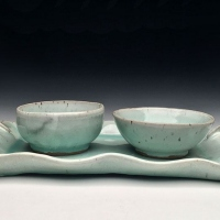Two ceramic bowls on a serving tray.