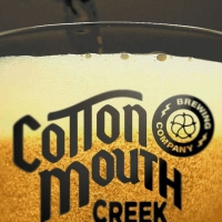 Cotton Mouth logo design on a cup full of beer.