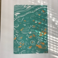 Print of a blue pond with orange fish in it.