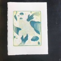 Abstract print of blue fish under water.