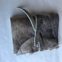 Photo of a fur book case on a table.